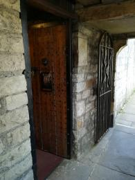 Wooden medieval door at the entrance.