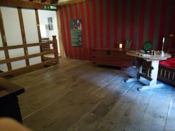A desk set on wooden floorboards in the Parlour.