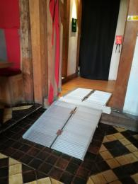 The portable ramp set up in the doorway between the Vestibule and the Great Hall.