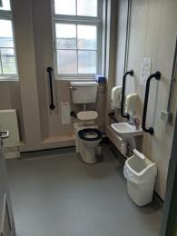 The accessible toilet, sink and grab rails.
