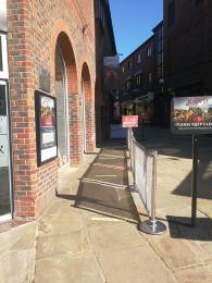 The queue area outside the JORVIK Viking Centre with a temporary barrier along the right side of the queue.