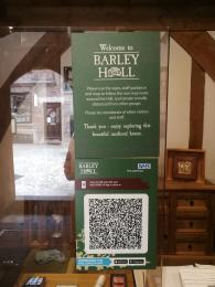 A sign containing instructions to follow the one-way system around Barley Hall as well as the NHS Track and Trace QR code.