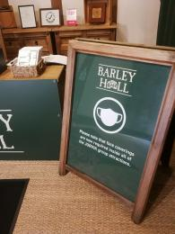 A sign informing visitors they must wear a face mask inside Barley Hall unless exempt.