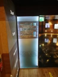 A frosted glass panel at the entrance to Discover Coppergate leading people along the wooden walkway.