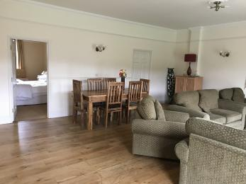 dining table and chairs, 2 settees, 2 armchairs