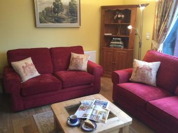 Two comfortable sofas and coffee table in the living area of Darwin Cottage