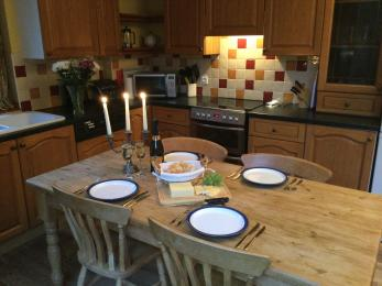 Dining table set with Denby plates with blue trim