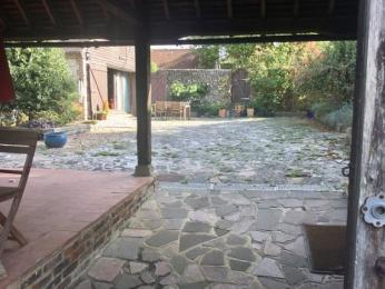 From the sliding gate, there is a gentle slope into the crazy paved courtyard