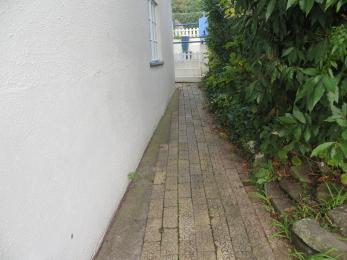 Further picture of the path along the right side of the building