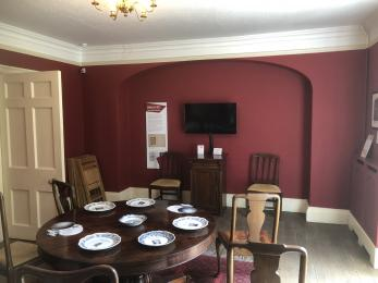 Dining Room showing seating and screen for introductory film