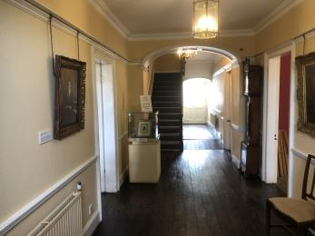 Entrance Hall with door to Visitor Reception on left