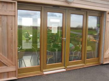 Glass entrance doors to cafe, manually opening, side hinged, 900mm wide