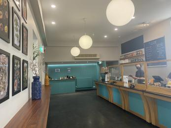 The cafe interior. The servery is to the left. There is a side board to the right.