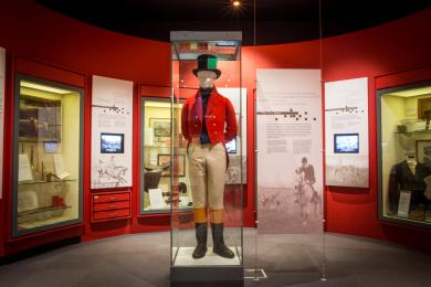 The History of Foxhunting gallery featuring displays and a costumed mannequin.