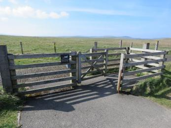 Kissing gate between accessible parking spaces and Brodgar trails