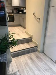 Two steps from kitchen to living/dining area
