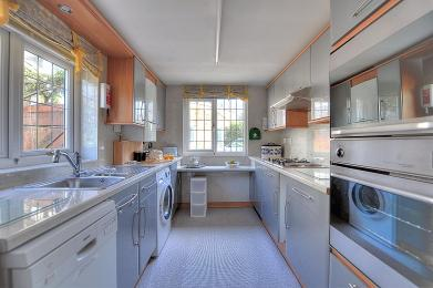 Wide angle view of the kitchen showing the main appliances.