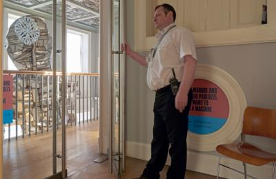 Level 2 - Great Hall Balcony doors being opened by member of staff