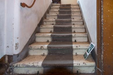 Photo of steps from library on east ground floor to landing showing risers and rope handrail