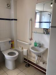 This photograph shows a view of the sink and toilet.