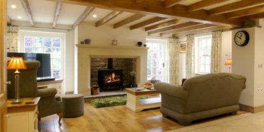 The Dairy, Newbiggin - lounge with log burning stove & access to the private patio