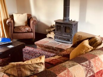 There is a comfortable lounge area with wood burning stove to keep guests warm in the winter.