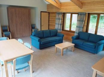 Lounge with sofas, dining area and fold-away, king-size bed