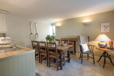 Open plan dining are with a farmhouse style table seating up to 6 people.