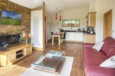 •	The main room in the property consists of the kitchen/dining area to the rear, and the sitting area to the front.