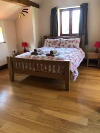 There is excellent space and access around the double bed in the main bedroom at the Vine House.