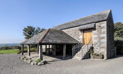 Mill Barn with steps to main entrance door on the right