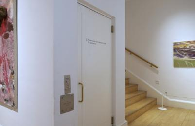 Modern One - Door to platform lift in Room 21, giving access to Room 20