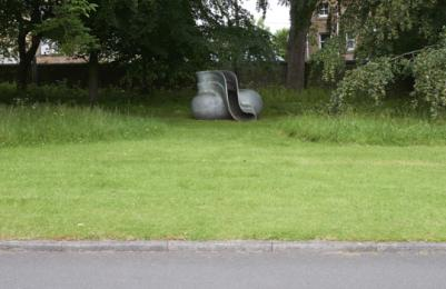 Modern One - Sculpture Park - sculpture on grassy area with kerb from road
