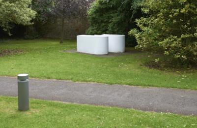 Modern One - Sculpture Park - sculpture on grassy area, no kerb from surfaced path