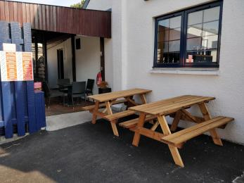 Picnic benches and entrance to outside seating area