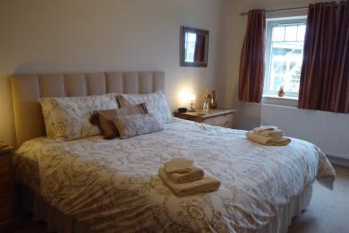 Amber ground floor bedroom showing super king bed