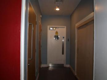 Corridor for ground floor accessible toilets – entrance by bar