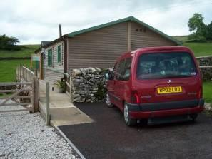 Parking space adjacent to cabin