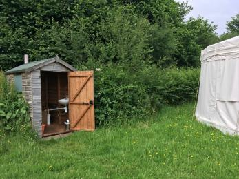 This shows how close the compost toilet is to Clover yurt