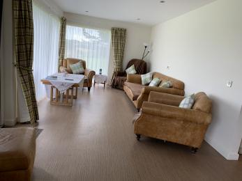 Machray living area with riser recliner chair.