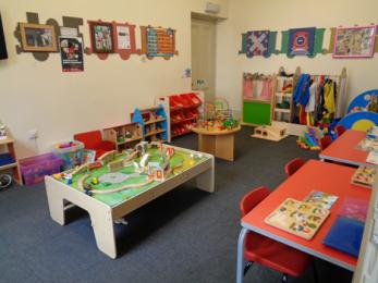 View of play room showing toys and furniture