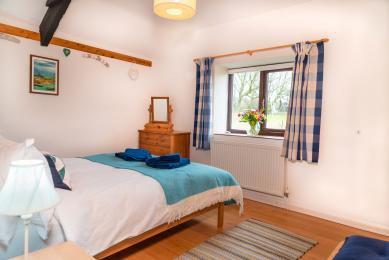 Blackberry is a lovely light cottage. The photo shows the light streaming in to the double bedroom