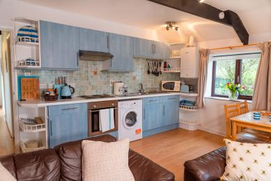 The light and airy double-aspect kitchen, lounge diner at Elderberry Cottage.