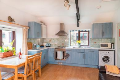 The sky-blue kitchen at Seaberry Cottage, Polrunny Farm.