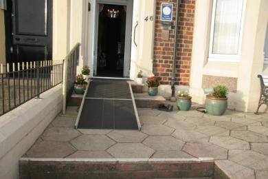 Portable ramp covers 3 steps onto the front terrace