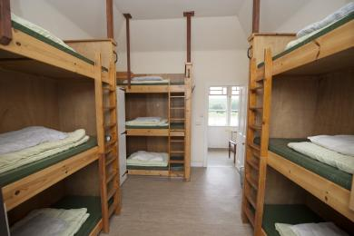 Triple Bunks in most rooms.