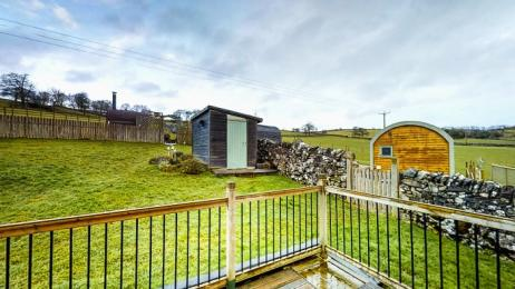 secure decking area with views over the farm fields