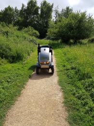 Mobility vehicle on rolled stone path