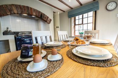 Breakfast table with crockery.