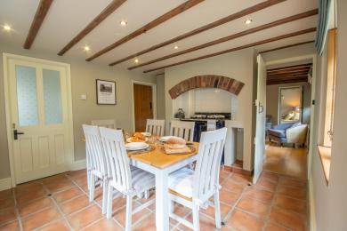 Contrast of colour between walls and doors the dining area being an example.